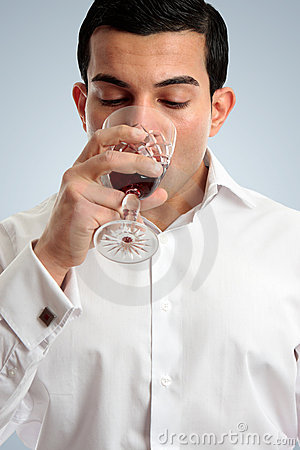Man tasting drinking wine