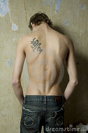 male back tattoos. MAN WITH TATTOO ON THE BACK
