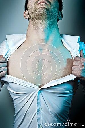Man tearing his shirt