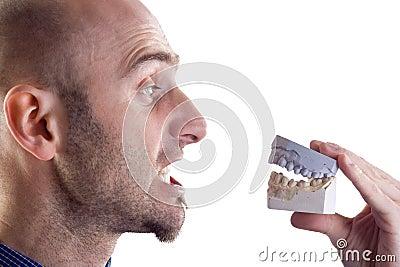 Man and teeth mold