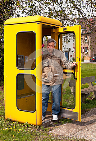 Man in telephone booth