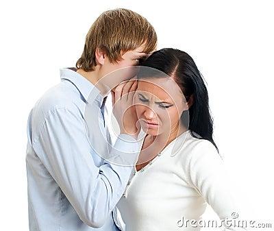 Man telling terrible secret to a woman.