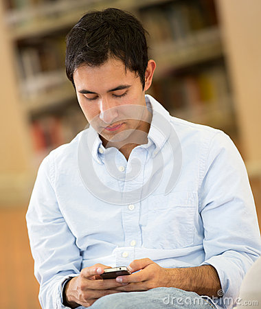 Man texting in the library