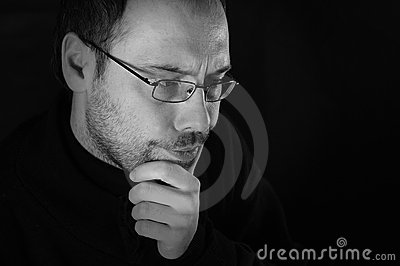 Man thinking with beard and glasses