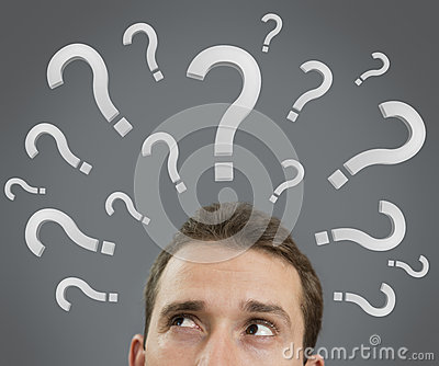 Man thinking concept with question marks