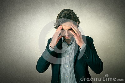 Man thinking or has head pain Stock Photo