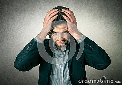 Man thinking or has head pain Stock Photo
