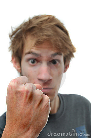 Man threatening with clenched fist