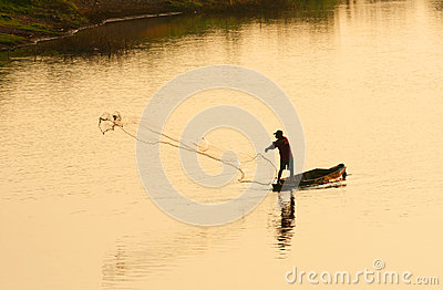 A man throw fishing net in evening