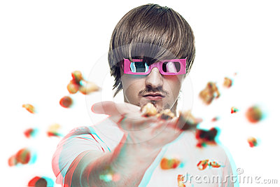 Man throwing popcorn at the viewer