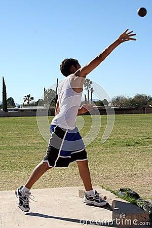 Man throwing shot put