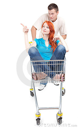 Man thrusting shop trolley, woman pointing