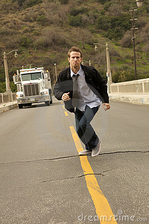 A Man In A  Tie Sprinting