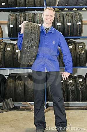 Man in the tire store with a tire