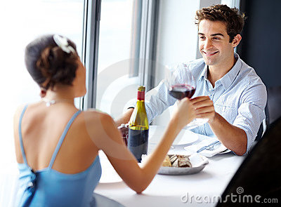 Man toasting wine with his girlfriend
