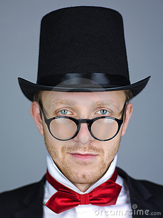 Man in top hat with bow