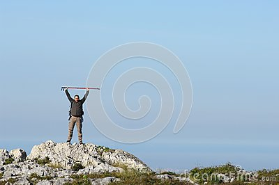Man in a top of a in mountain hiking