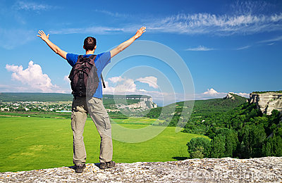 Man on top of mountain. Tourism concept.