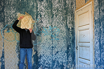 Man with torn wallpaper