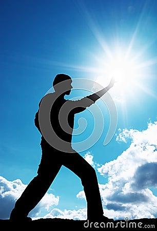 Man touch sun
