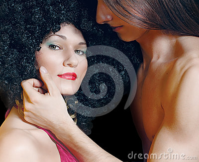 Man touching the face of woman