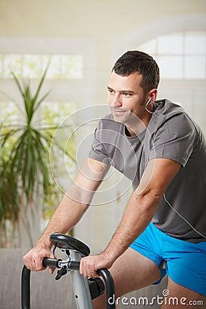 Man training on exercise bike