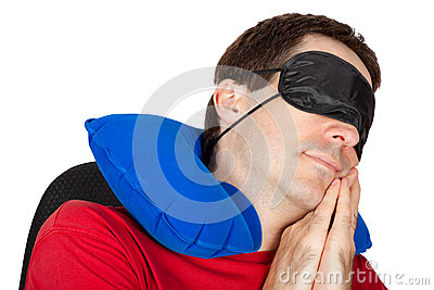 Man with travel Neck Pillow and Sleeping mask