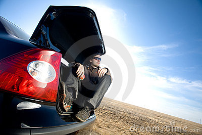 Man in trunk of car
