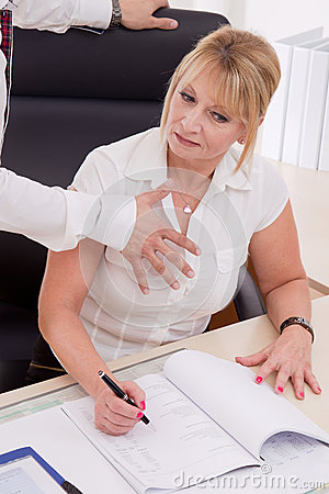 Man try to touch businesswoman at work - concept for bullying.