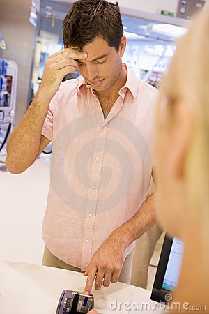 Man trying to remember card PIN number