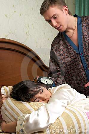 Man trying to wake his wife