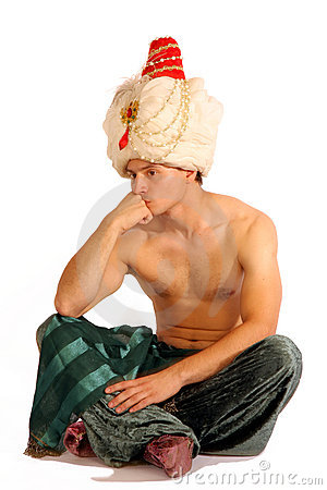 Man in turban sits and thinks