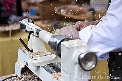 Man turning wood