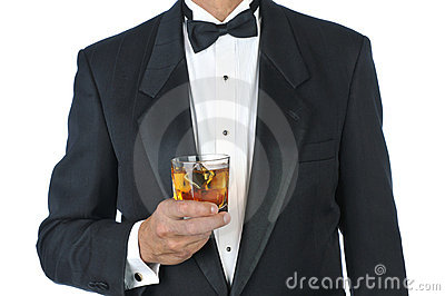 Man in Tuxedo Holding Cocktail