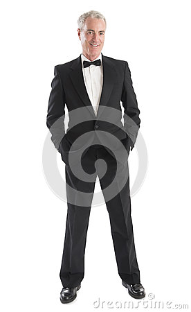 Man In Tuxedo Standing With Hands In Pocket