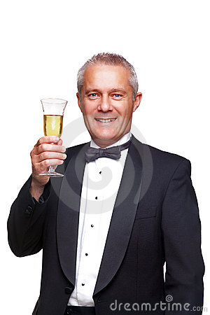 Man in tuxedo toasting with champagne.