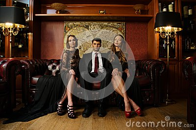 Man with two beautiful women