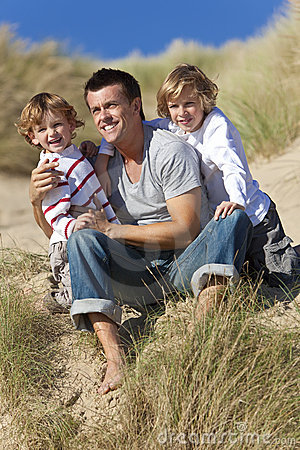Man & Two Boy, Father and Sons Having Fun At Beach