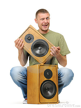 Man with two wooden speaker on white