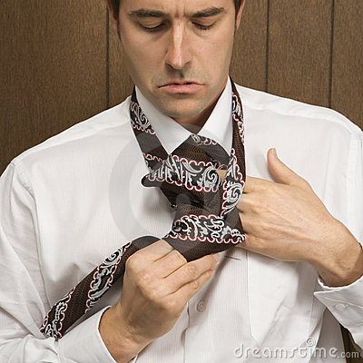 Free Man Tying His Necktie. Stock Photos - 2047093