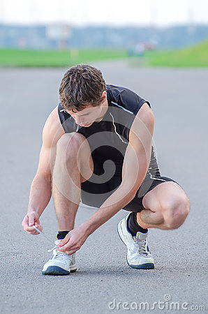 Man tying his sport shoes