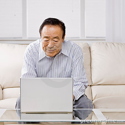 Man typing on laptop