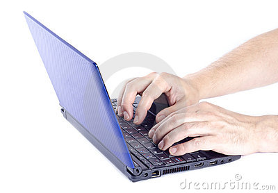 Man Typing on a Mini Netbook