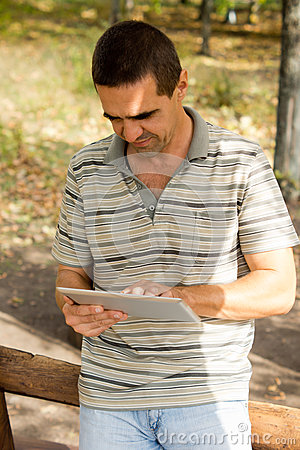 Man typing on a tablet