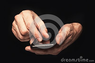Man typing a text message on a smartphone