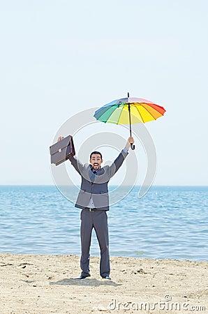 Man with umbrella on beach