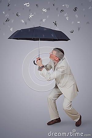 Man with umbrella under rain currency