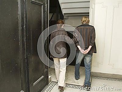 Man under arrest in handcuffs_1