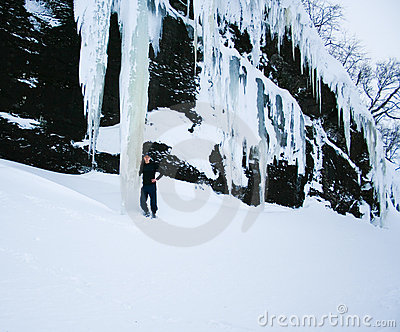Man under gigantic icicles