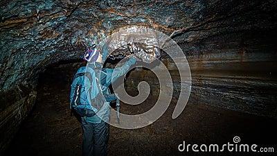 A man in an underground tunnel.